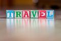 Toy letter blocks spelling the word travel - PhotoDune Item for Sale