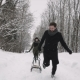A Guy and a Girl Play in the Snow in the Forest. Winter Fun - VideoHive Item for Sale