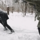 A Guy and a Girl Play in the Snow in the Park. Winter Fun - VideoHive Item for Sale