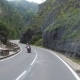 Motorcyclist Rides on a Beautiful Landscape Mountain Road in Austria - VideoHive Item for Sale