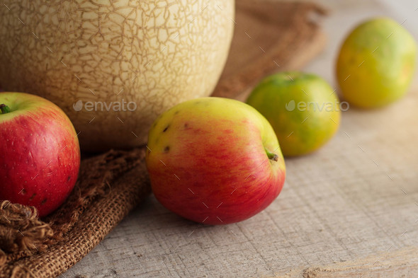 Apples with black spots on wood - Stock Photo - Images
