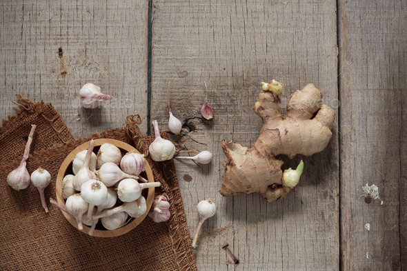 Garlic and ginger on floor - Stock Photo - Images