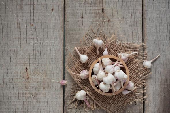 Garlic on wooden floor - Stock Photo - Images