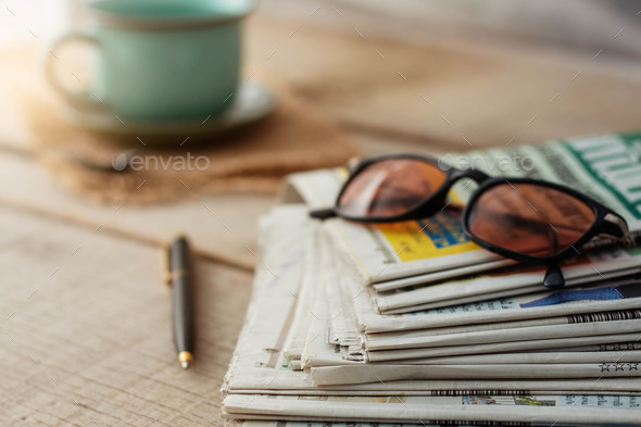 Newspapers on wooden floors - Stock Photo - Images
