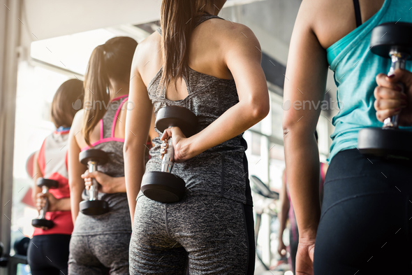 Group of woman lifting weights with dumbbells - Stock Photo - Images