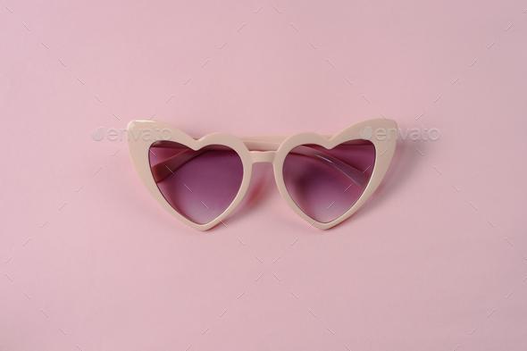 b784d729f26 Pink heart shape sunglasses isolated stock photo kitzstocker JPG 590x393 Pink  heart shaped sunglasses