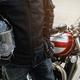 Biker wear jacket suit hold helmet with retro motorcycle - PhotoDune Item for Sale