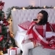 Girl Is Covered By a Rug Near the Christmas Tree - VideoHive Item for Sale