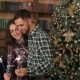 Happy Couple Holding Sparklers Near Christmas Tree - VideoHive Item for Sale