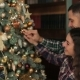 Happy Couple Decorating Christmas Tree in Home - VideoHive Item for Sale