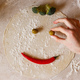 Dough basis for pizza in the shape of smile, on the table - PhotoDune Item for Sale