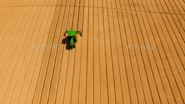 Green Tractor Plowing Aerating For New Planting Farm Agriculture - Stock Photo - Images