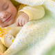 Cute baby sleeping with Easter decorations - PhotoDune Item for Sale