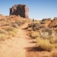 Woman Walking in Monument Valley with Red Rocks Overview - VideoHive Item for Sale