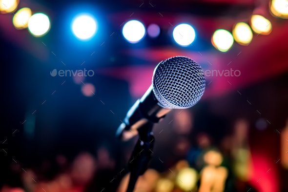 Microphone on stage against a background of auditorium. - Stock Photo - Images