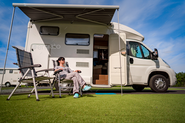 Woman resting near motorhomes in nature. Family vacation travel, - Stock Photo - Images