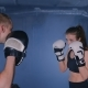 Young Woman with Trainer at Boxing and Self Defense Lesson in a Smoky Gym - VideoHive Item for Sale