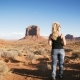 Woman Standing in Monument Valley with Red Rocks Overview. - VideoHive Item for Sale