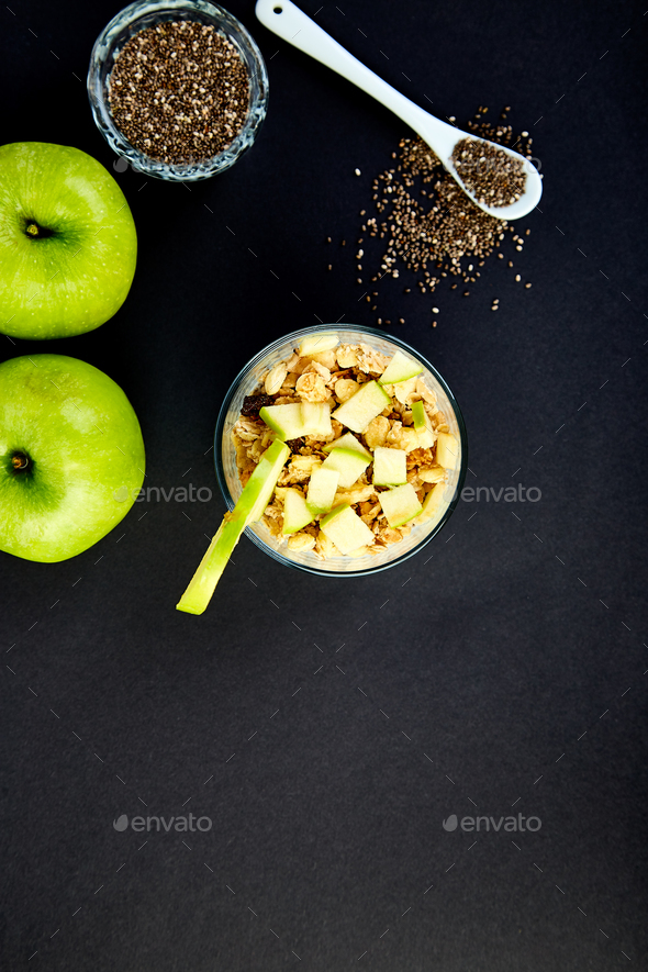 Healthy chia pudding with apples and granola in glass. - Stock Photo - Images