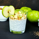 Healthy chia pudding with apples and granola in glass. - PhotoDune Item for Sale
