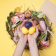 Easter card. Painted Easter eggs in nest on yellow background - PhotoDune Item for Sale