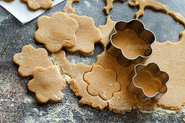 Cooking cookies with flower cookie cutters - Stock Photo - Images