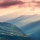 Beautiful hills with green meadows, forest, orange sky - PhotoDune Item for Sale