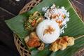 indonesian food and satay served using banana leaf - PhotoDune Item for Sale