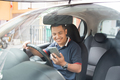 man using smartphone while driving a car - PhotoDune Item for Sale