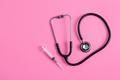 stethoscope and syringe on pink pastel background - PhotoDune Item for Sale