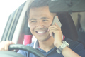 man using mobile phone while driving his car - PhotoDune Item for Sale