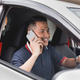 man calling while driving a car - PhotoDune Item for Sale