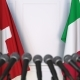 Flags of Switzerland and Italy at International Press Conference - VideoHive Item for Sale