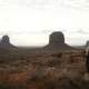 Woman Taking Pictures in Monument Valley with a Camera - VideoHive Item for Sale