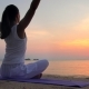 Young Woman Meditates at the Sunset Sea - VideoHive Item for Sale