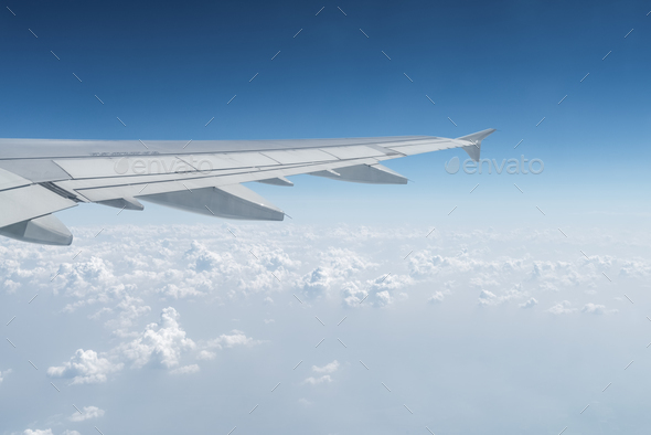 airplane wing in the sky, travel by plane - Stock Photo - Images