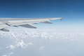 airplane wing in the sky, travel by plane - PhotoDune Item for Sale
