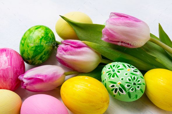 Easter background with green, yellow, pink painted eggs in the n - Stock Photo - Images