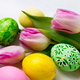 Easter background with green, yellow, pink painted eggs in the n - PhotoDune Item for Sale