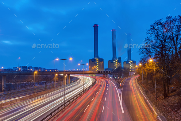 Power station and highway at dawn  - Stock Photo - Images