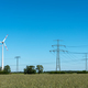 Overhead lines and wind turbines on a sunny day - PhotoDune Item for Sale
