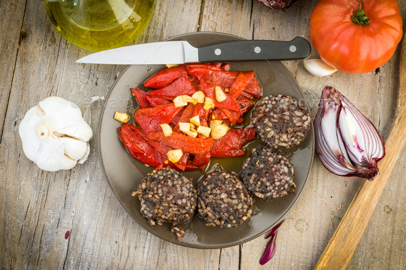 fried peppers and sausage served on wooden board - Stock Photo - Images