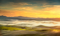 Volterra foggy panorama, rolling hills and green fields on sunse - PhotoDune Item for Sale