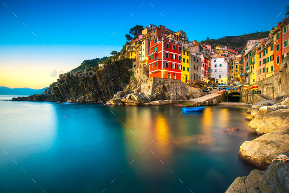 Riomaggiore town, cape and sea landscape at sunset. Cinque Terre - Stock Photo - Images