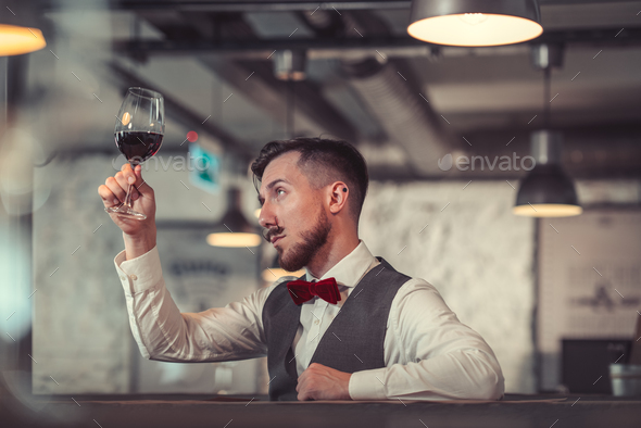 Young man in a cafe - Stock Photo - Images