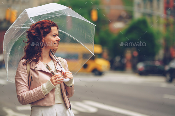 Smiling girl with an umbrella - Stock Photo - Images