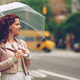 Smiling girl with an umbrella - PhotoDune Item for Sale