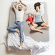 Top view of happy family with one newborn child in bedroom. - PhotoDune Item for Sale