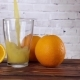 Orange Juice Pouring in Glass on Brick Wall Background,  Video - VideoHive Item for Sale
