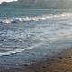 Ocean waves on sandy beach at sunset - PhotoDune Item for Sale